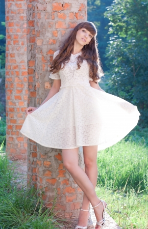 Beautiful girl in a white dress on the nature, portrait Stock Photo