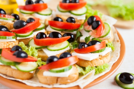 Canape with cheese feta and vegetables, close up photo