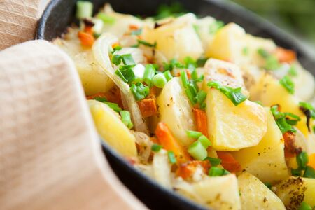 Golden potatoes, hot casserole, food close up photo