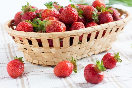 a basket of ripe strawberries on a napkin, close up Stock Photo - 16724683