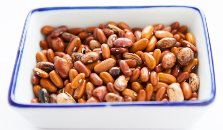 Dry raw beans in a square container, close up Stock Photo - 16756630