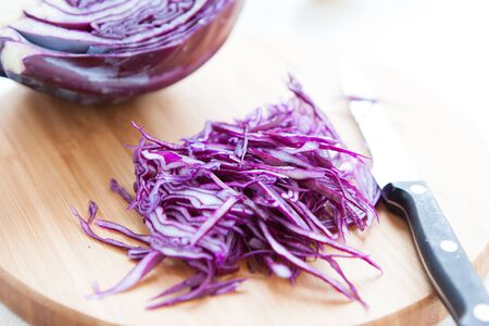 appetize: thinly sliced red cabbage on a cutting board, close up