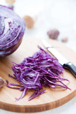 appetize:  sliced red cabbage on a cutting board, vertical close up Stock Photo
