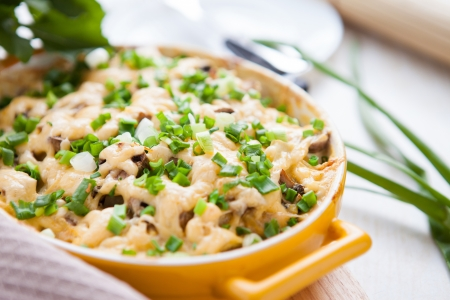 mushroom casserole with cheese and herbs, close up photo