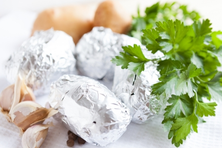 Raw potatoes wrapped in foil, food close-up Stock Photo - 16831982