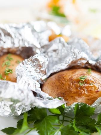 potatoes roasted in a peel on grill, close-up Stock Photo - 16831972