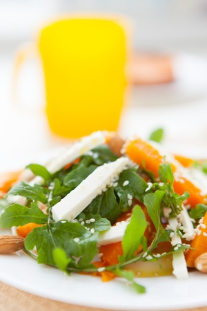 Salad with roasted pumpkin and arugula, close-up Stock Photo - 16952895