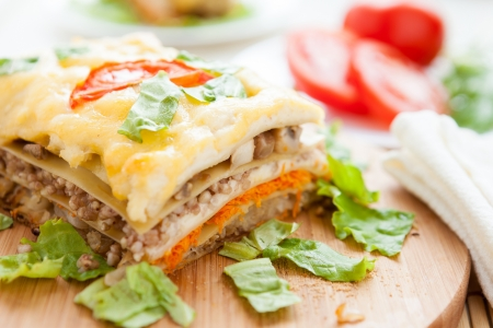 Vegetable lasagna on a wooden board, food closeup photo