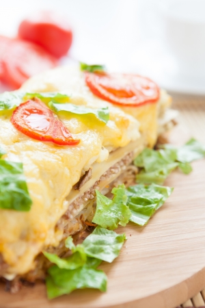 vegetable lasagna with cheese and tomatoes, close up photo