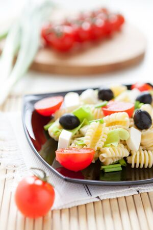 pasta with cheese and cherry tomatoes, close up Stock Photo - 17170258
