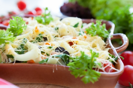 Vegetable pasta with cheese in a pot, close up photo