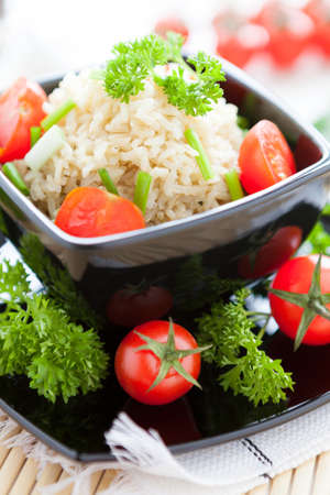 unpolished: unpolished rice cooked with fresh tomatoes, healthy eating close up