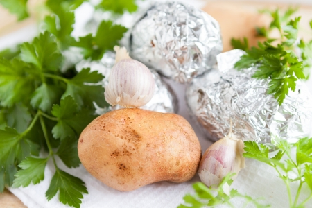 raw potato close up and the potatoes in foil, raw food Stock Photo - 17280607