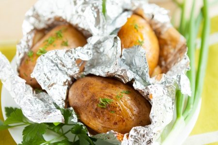potatoes baked in foil with herbs, close-up Stock Photo - 17280617