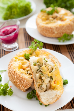 bun stuffed with mushrooms and chicken with cheese, close up