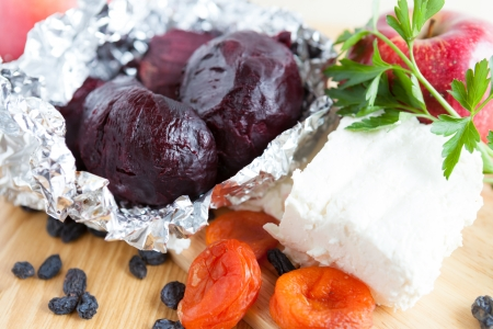roasted vegetables and raw cottage cheese, closeup