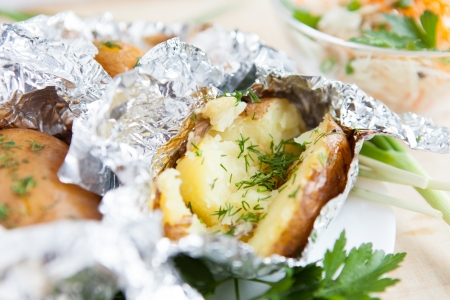 flavored with dill potatoes cooked in foil, close up Stock Photo - 17364189