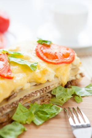 lasagna with vegetables and grains, closeup photo