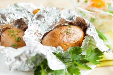 whole potato in foil, and parsley, close-up Stock Photo - 17512119
