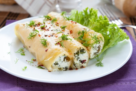 italian cannelloni stuffed with spinach and cheese, closeup