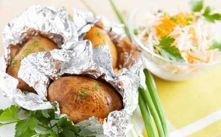 Jacket potatoes baked in foil, and fresh greens Stock Photo - 17742455