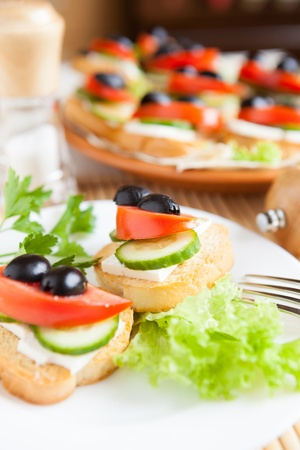 canape with olives and cheese, closeup photo