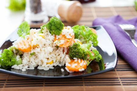 boiled white rice with vegetables, closeup