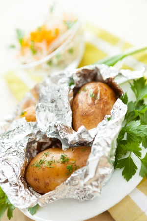 baked potato and salad in the background, close-up Stock Photo - 17873278
