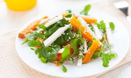 spicy salad with arugula and pumpkin, closeup Stock Photo - 17873153