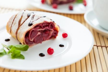 cherry strudel with chocolate sauce, closeup
