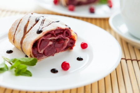 cherry strudel with chocolate sauce, closeup