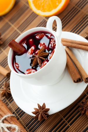 Traditional hot wine with almonds and cinnamon, closeup