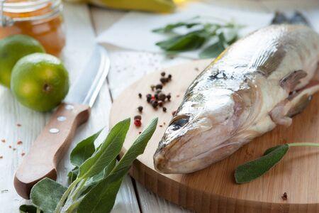 raw fish on a cutting board, perch closeup Stock Photo - 18441899