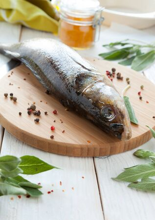 raw fish and spices on a cutting board, perch closeup Stock Photo - 18441855