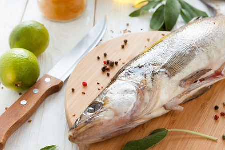 raw fish close-up on chopping board, zander Stock Photo - 18500077