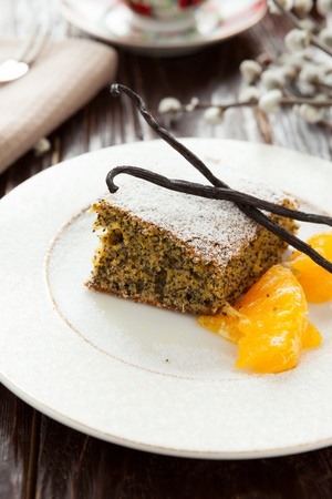 vanilla pie with poppy seeds and orange, closeup photo