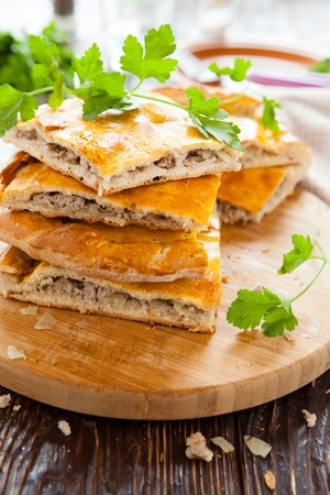 delicious meat pie slices and parsley, closeuo food Stock Photo - 18599616