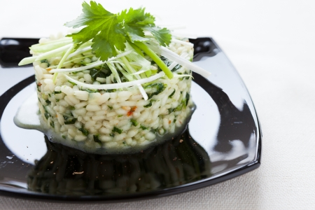 risotto with spinach on a platter, closeup photo