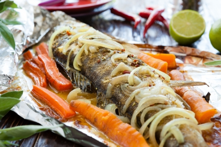 freshwater fish baked in foil, closeup Stock Photo - 18789035