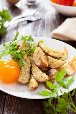 Baked potatoes with garlic, closeup food