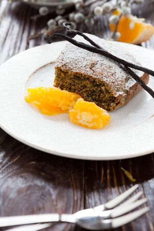 poppy seed dessert with orange, closeup food photo