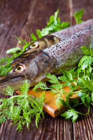 Raw fish and greens on the table, closeup Stock Photo - 19157570
