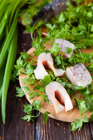 Fish fillets and fresh herbs, pike top view Stock Photo - 19157573