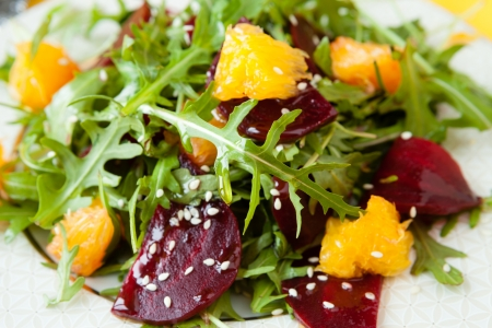 beets: fresh salad with beets and oranges, closeup