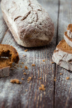 Brewed square bread loaf and pieces, closeup photo