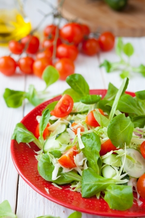 fresh salad with cabbage and tomatoes, food closeup Stock Photo