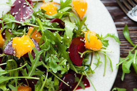 rocket lettuce: fresh green salad with arugula and beets, food closeup Stock Photo