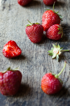 fresh strawberry on a wooden table, food closeup photo