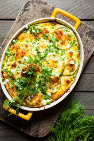 zucchini baked with cheese in a dish, close up food Stock Photo