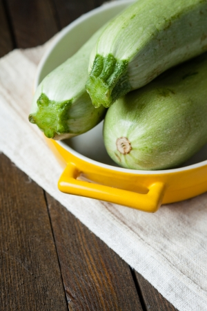 raw zucchini in a baking dish, fresh food Stock Photo